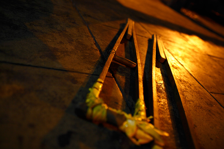 One of the homeless person's well-used crutches lie in the dark at the underpass structure of the bus terminal.