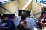 "People use the underpass structure at the bus terminal and cross ""into"" the homeless persons' living quarters."
