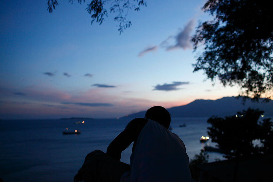 A man looks over the Subic Bay as the sun sets in Olongapo, Philippines.
