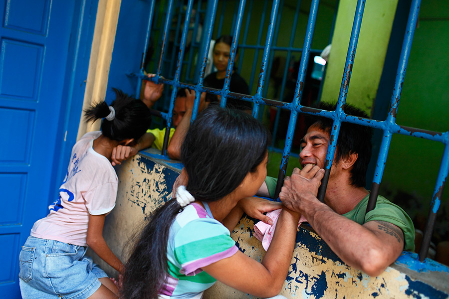 A jail visitation scene inside the Caloocan police headquarters in Manila, Philippines.