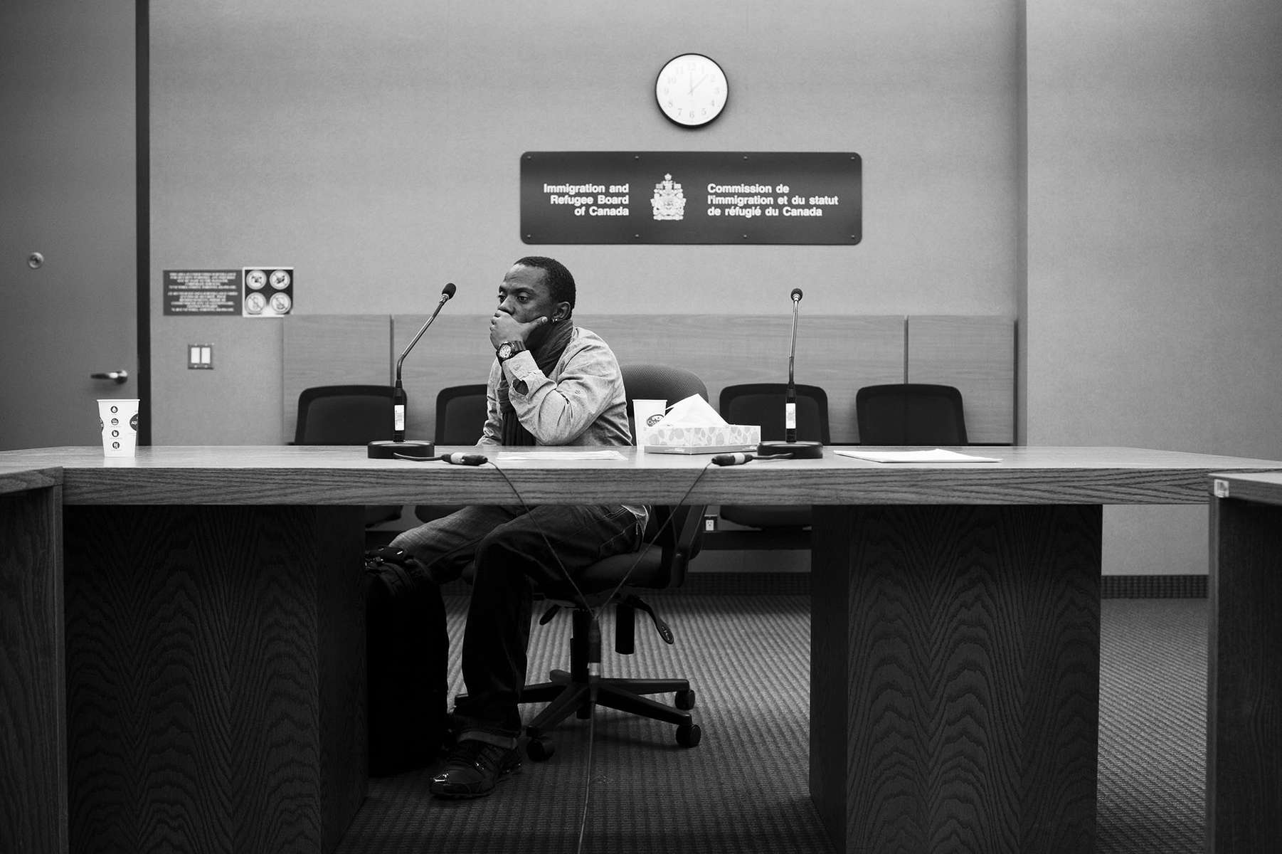 "TORONTO, ON: DECEMBER 2, 2013Abdulah reacts after his hearing at the Immigration and Refugee Board of Canada. He fled Uganda to Canada three days after he was imprisoned and tortured by local police because of his sexual orientation. Being gay in Uganda is a criminal offence and same-sex acts are punishable with life imprisonment.Last December, Mr. Aziz Ssali tried claiming refugee status but was rejected. Shortly after the ""negative"" decision, a Ugandan tabloid newspaper published a list of the country's homosexuals that included his name. He is currently appealing the decision and will be able to present this as additional evidence in his case. If the decision is upheld, he is unsure of where he will go or what he will do.(Image first published June 22, 2014 in The Globe and Mail)http://www.theglobeandmail.com/news/national/worldpride/article19285991/"