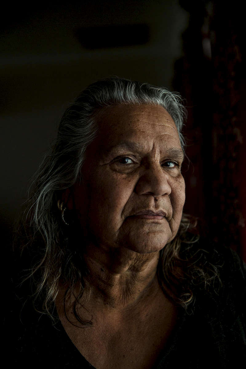 "Joyce Napurrula-Schroeder was taken from Phillip Creek, north of Tennant Creek, in 1947 with 15 other children, and placed in the Retta Dixon Home in Darwin. She was not quite 2 years old. Joyce says she was sexually abused during her time at Retta Dixon, and volunteered her testimony to the Royal Commission into Institutional Responses to Child Sexual Abuse last year. She remained in Retta Dixon for over fifteen years until she got married in 1963. ""A lot us in my age group sort of married the first man we met, and unfortunately most of marriages didn't last, because, you know, I think when you grow up in a mission you're so young, and when you're not nurtured, you're not nursed, you're not hugged, you're not given any love, how can you give love if you've never known love?"" She continues, ""Most of us went from the mission into an abusive relationship… a lot of that, I'm sure, had to do with the mission.""""I think thats what upset us most, the fact that we didn't know where we came from. We didn't know where our family was. We didn't know who we belonged to… definitely stolen generation, and lost, lost generation as well. Most of us were lost for all that time… and even though you meet your family… even though I met mom and everything, you don't get that closeness with your mother… because you were taken away."""