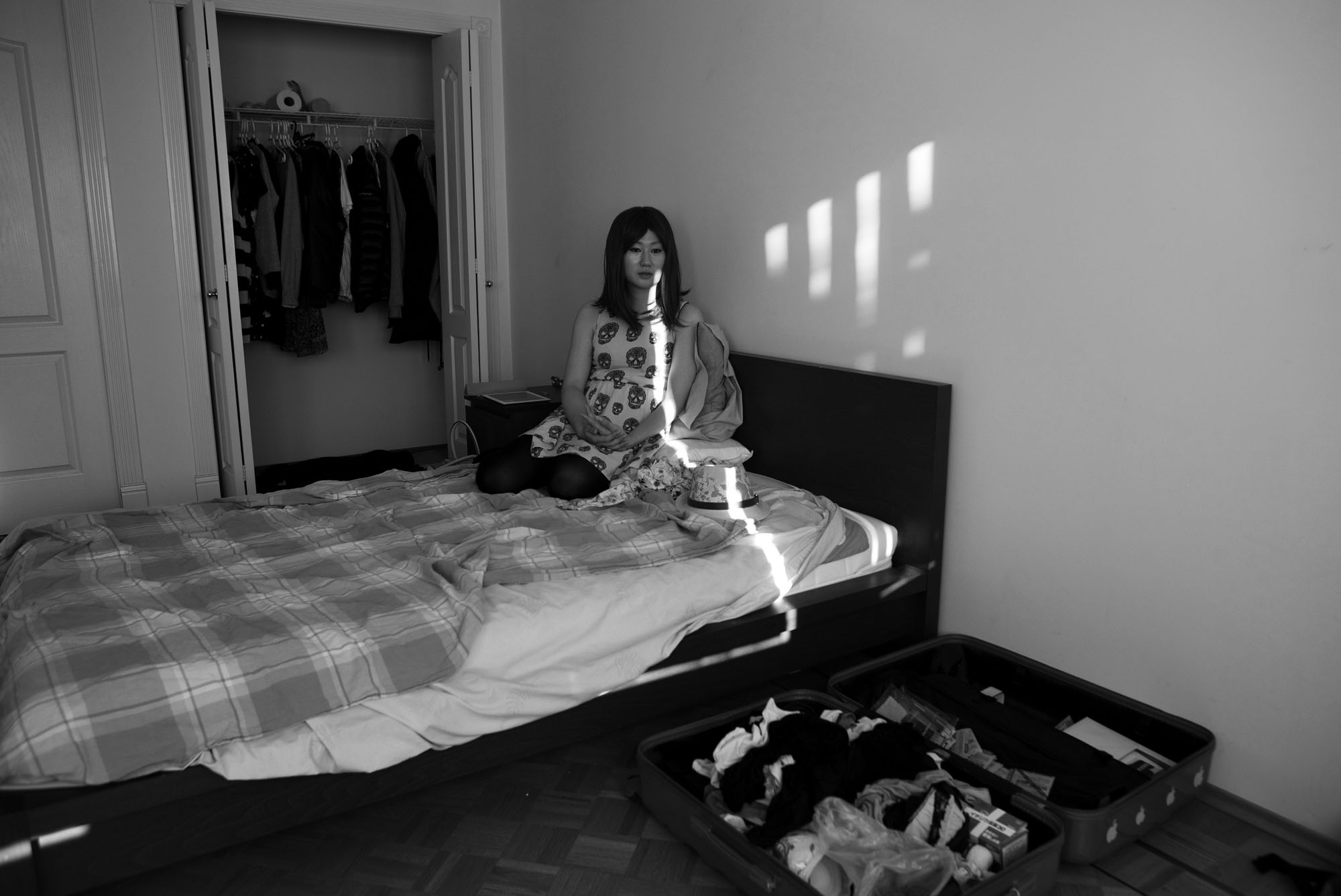 Kate (alias) a male to female transgender refugee from South Korea, sits on her bed in a room she rents in Surrey, BC., on May 27, 2014. Kate came to Canada from South Korea after being conscripted to the military. Kate identifies as female and was not comfortable being forced to live and shower with strange men for two years of service. She was told she had to get a sex change to avoid service, join the military or be imprisoned. Kate had a successful hearing earlier in May and will eventually become a permanent resident.