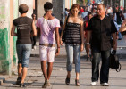 Two gay men are glared at as they walk down the street in Havana.