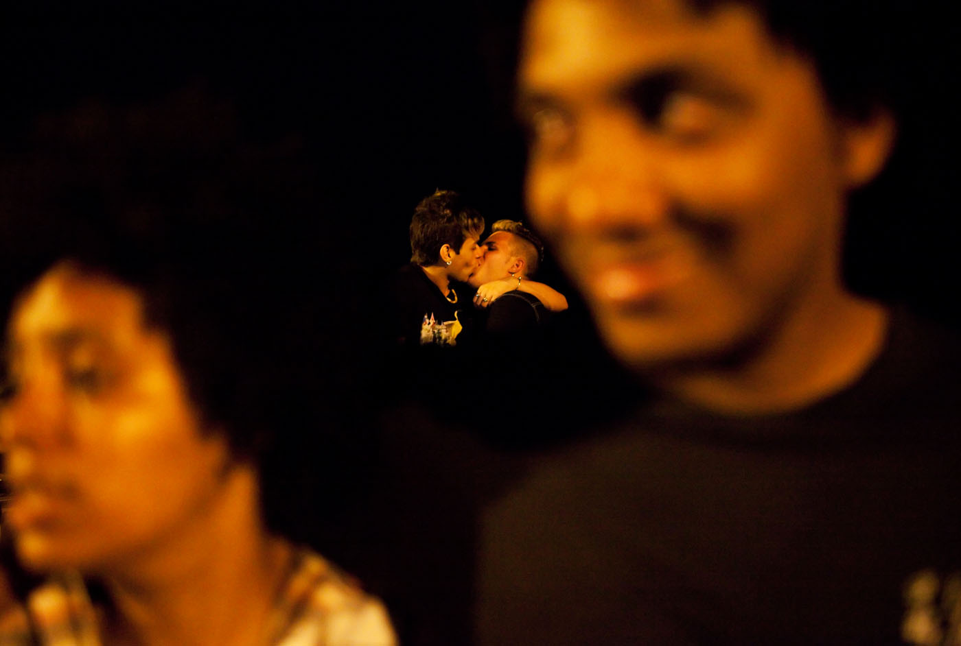 Two boys kiss while sitting on the sea wall along the Malecón. Much of Cuban life is lived on the streets. On a Friday or Saturday night, the strip of seawall from Calle 23 to Havana Vieja is lined with people of all sexes and genders expressing themselves openly.