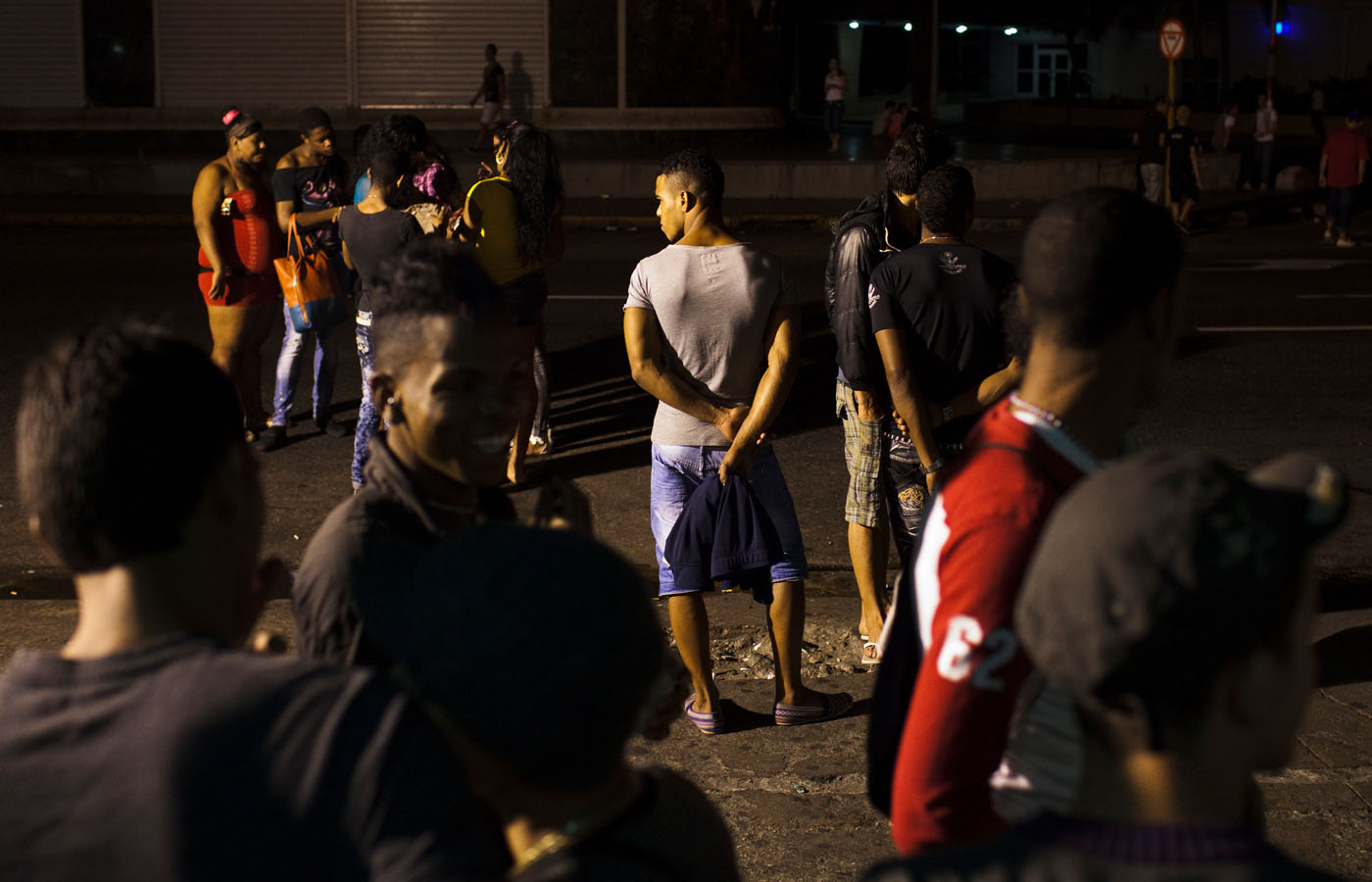 Men, women and transgender people gather at the corner of Infanta and Calle 23 in Havana. This corner is a popular location for the LGBT community on any night of the week. Public gatherings of LGBT people were rare until roughly five years ago because of police and community discrimination.