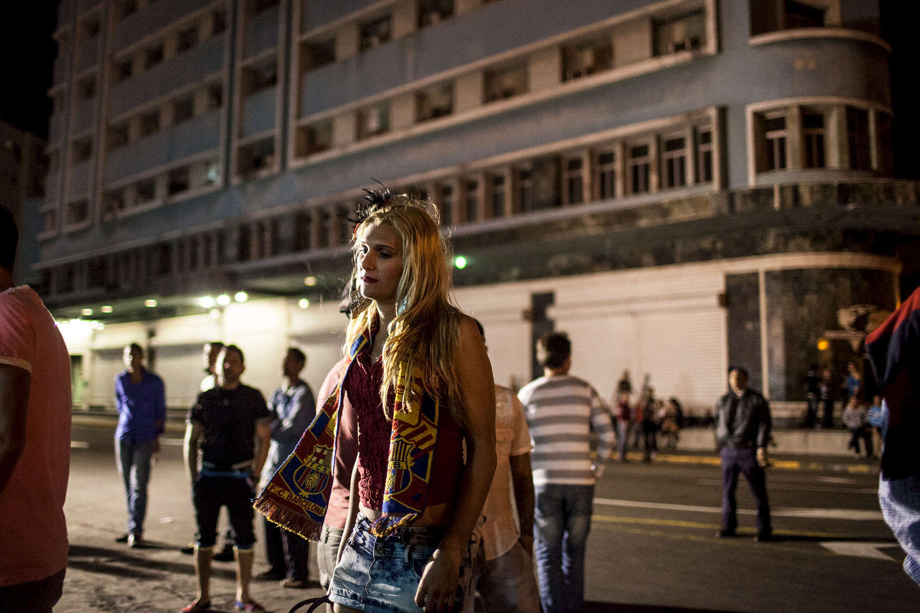 A transgender woman walks by a popular gay meeting area near the Malecon and Calle 23 in Havana.