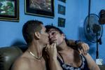 Cici, a transgender woman, kisses her boyfriend.
