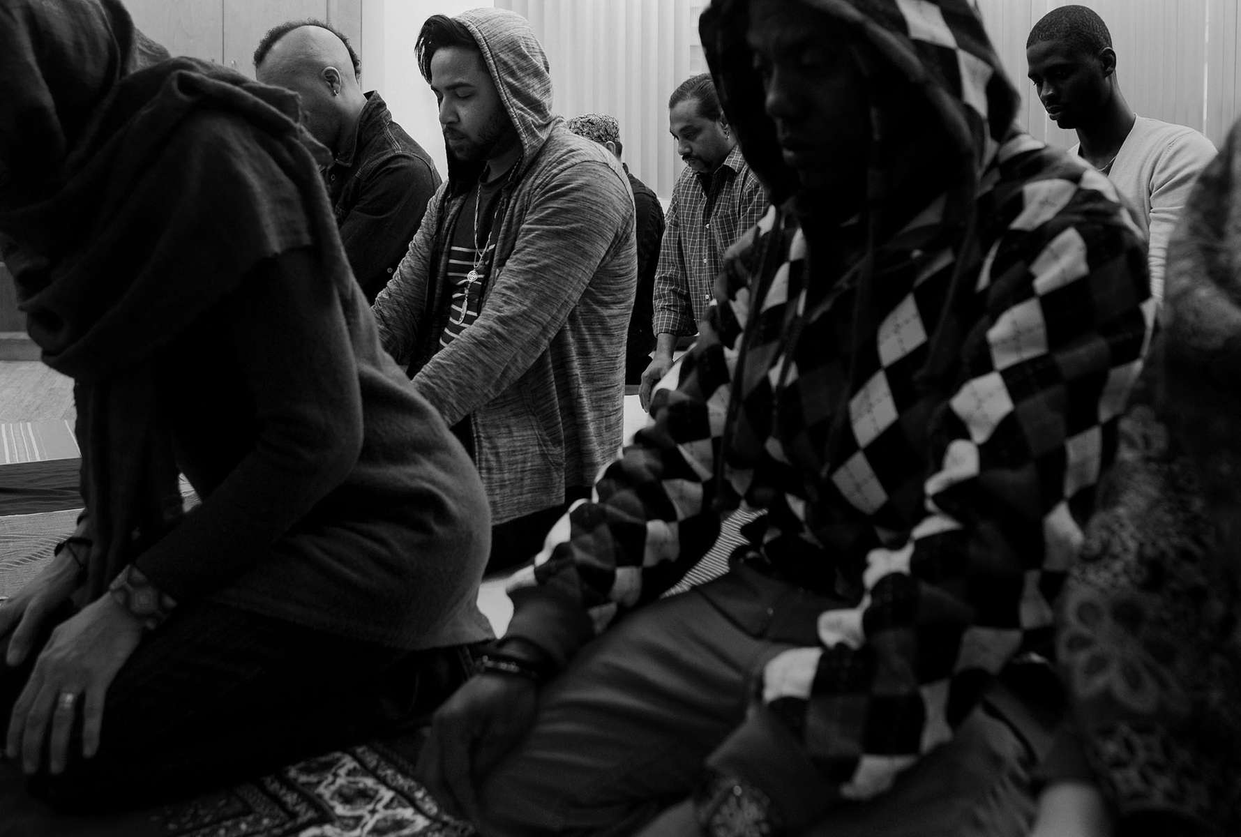 TORONTO, ON: MARCH 28, 2014 Rodney de Roche, centre left, prays at Friday congregational prayers at the Toronto Unity Mosque, on March 28, 2014. Rodney came to Canada from Trinidad and Tobago to escape a gang that was threatening his life an extorting him for money after discovering that he was gay. He had a travel agency in Trinidad, and used his business earnings to pay the gang over $5000. After they returned and demanded more money, which he could not pay, they threatened his life saying that he was a tree that no longer produced fruit, so they were going to cut it down.He had a positive hearing in April and will remain in Canada.