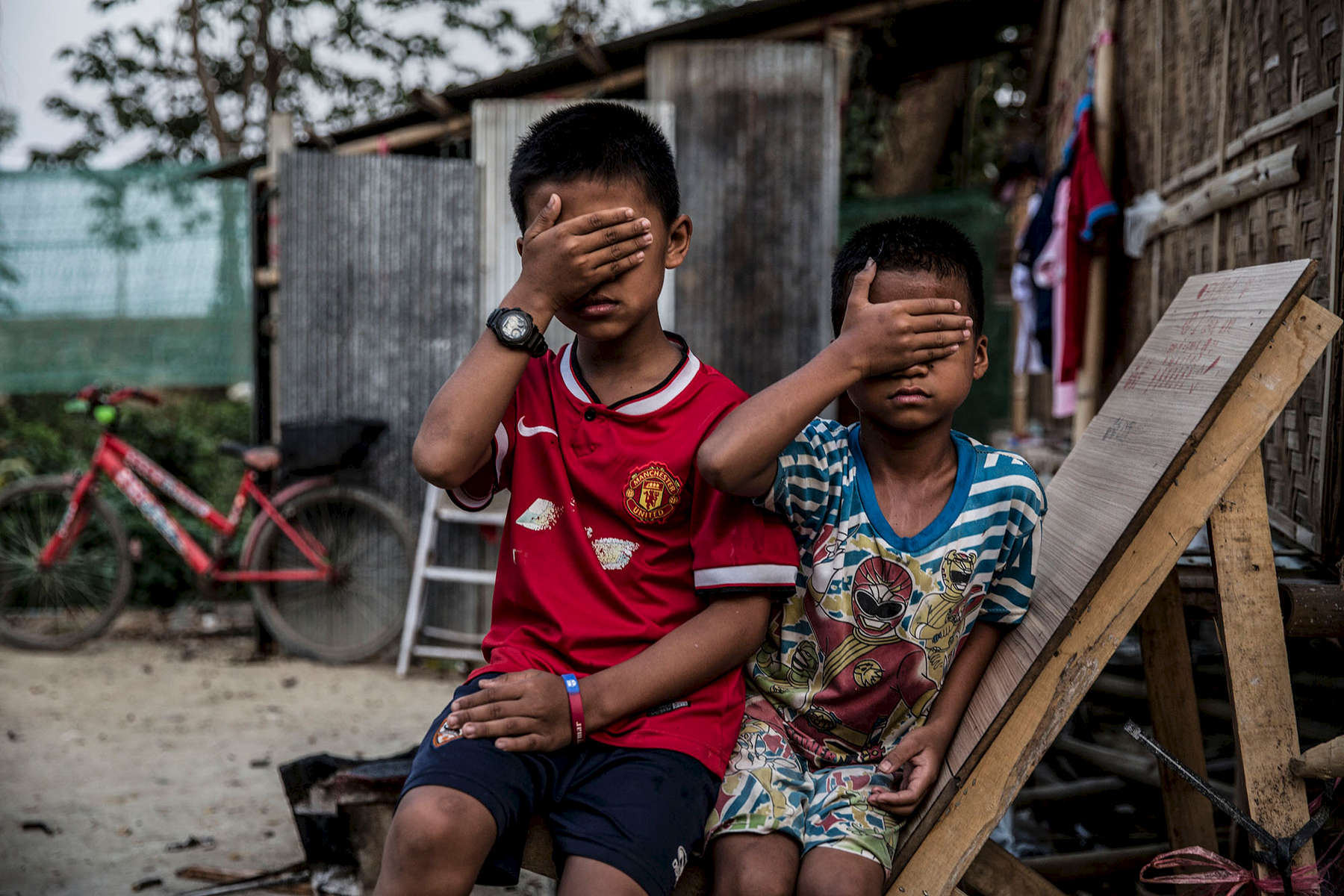 Boys whose parents fled Shan State, Myanmar, because they feared their sons would be forced to fight for the Burmese army or the Shan State armies.