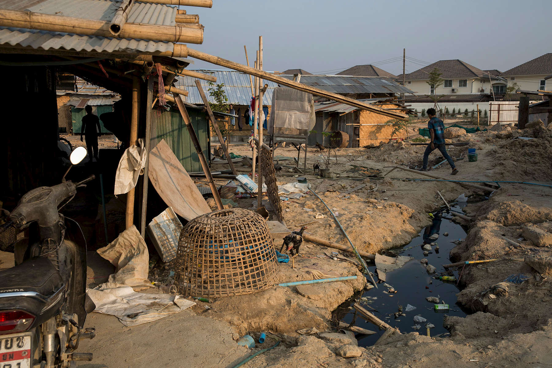 Standing water and sewage pose health problems for many migrant camps.