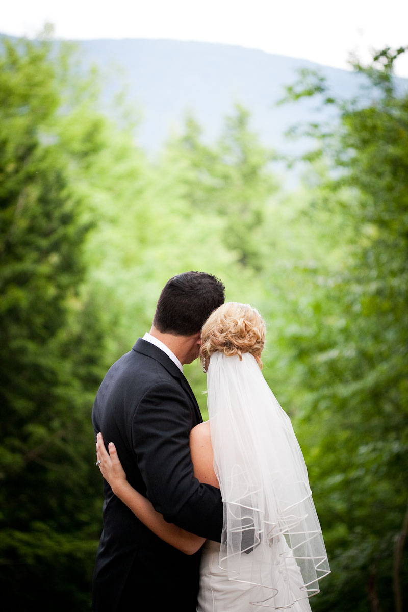 bride and groom at wedding in sunderland vermont. by vermont wedding photographers eve event photography