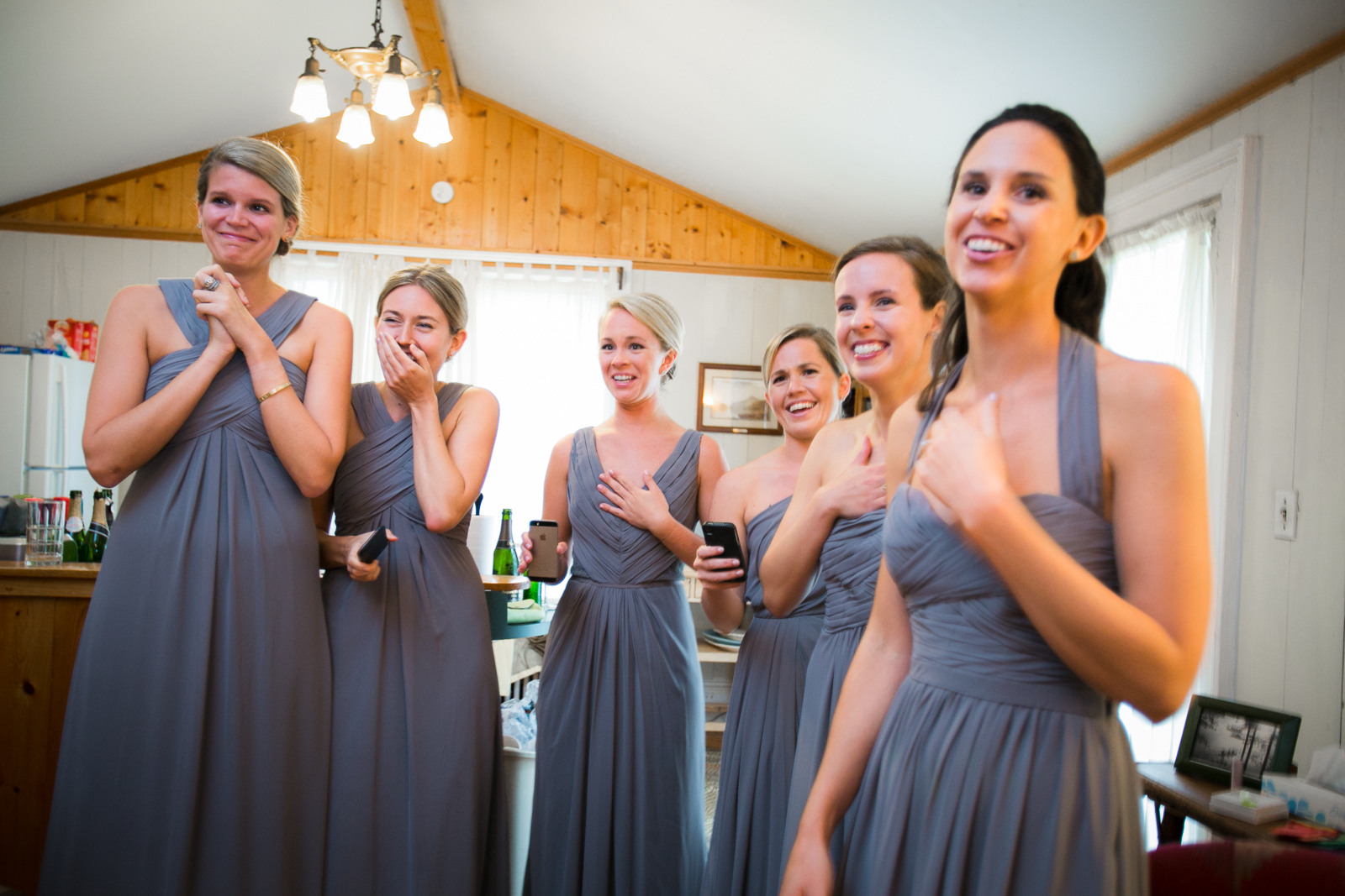 Bridesmaids captured reacting to their first look at the bride as she gets ready to walk down the aisle.