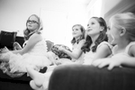 Adorable black and white photo of flower girls and other young wedding guests enjoying the celebration.