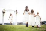 A delicate and one of a kind photo of young flower girls before the wedding ceremony at the Ferry Watch Inn in Grand Isle Vermont.