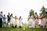 Bridal party plays tug of war at the Ferry Watch Inn in Grand Isle. By Vermont wedding photographers Eve Event Photography