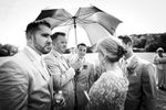 Wedding guests try to escape the heat with umbrellas at this summertime vermont wedding at the mountaintop inn in chittenden vermont.