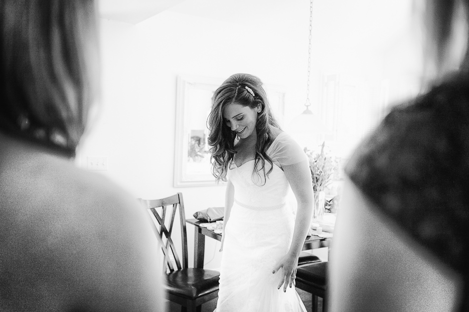 Bridesmaids look on as the stunning bride takes a moment before walking down the aisle at her stunning South Burlington VT Wedding.