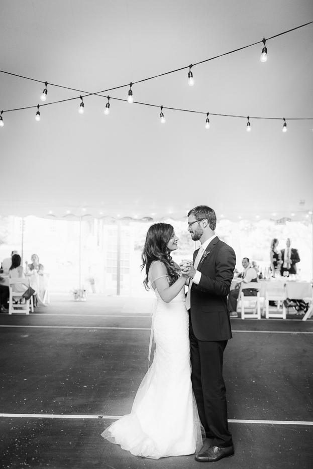 The bride and groom share their first dance in a picturesque Vermont barn.