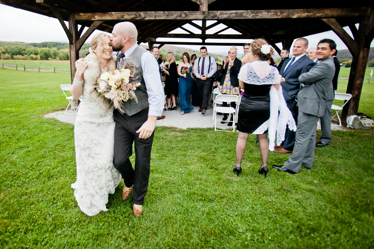 Kristin & Luke are wed at Boyden Valley Farm in Cambridge. By Vermont wedding photographers at Eve Event Photography
