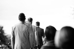 Vermont wedding photographers at Eve Event Photography capture groomsmen going down the aisle at Shelburne Museum.