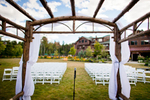 A microphone stands before an empty ceremony site at Kelly and Sepehr's wedding. Whiteface Lodge in Lake Placid, New York. by Vermont wedding photographers Eve Event Photography
