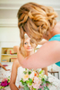 Bride getting ready at Turner Farmhouse in North Hero, by Vermont wedding photographers at Eve Event Photography