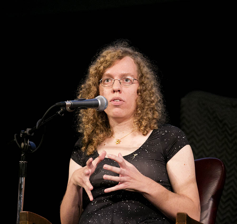 Elizabeth Howell speaking at a live recording of the Planetary Radio podcast at Convocation Hall at University of Toronto.