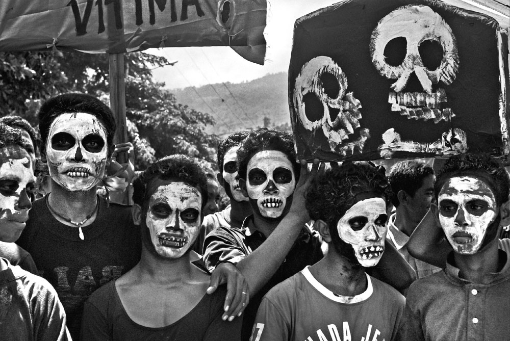 Bibi Bulak Theatre Company and Arte Moris students with a symbolic coffin at the gates of the cemetery. SANTA CRUZ MEMORIAL. DILI, EAST TIMOR.