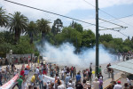 CS gas drifting up the street forces protesters to disperse away from the Greek parliament. June 29, 2011.