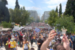 Demonstrators gather to protest the memorandum which is before the parliament on the second day of an historic 48 hour general strike. Athens, Greece. June 29, 2011.