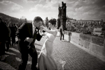 Prague Fine Art Black & White Elopement Photography. First dance on the Charles Bridge in Prague. Chicago wedding photographers document elopements of American couples in Prague, Czechia.