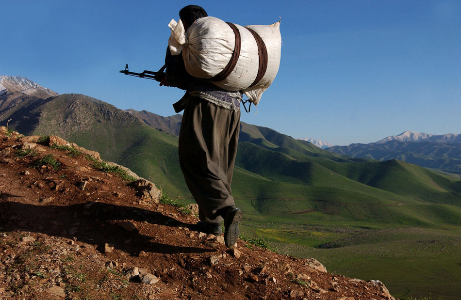 A Peshmerga soldier takes to the mountains to fight Al Qaeda splinter group, Ansar al Islam, along side U.S. Special Forces.