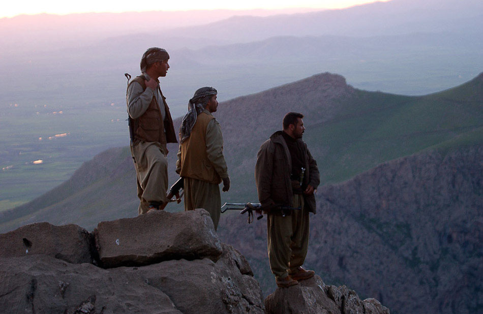 Peshmerga soldiers watch U.S. Special Forces fight Ansar al Islam on the Iraq-Iran border.