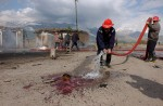 Following U.S. missile strikes, the Islamic extremist group Ansar al Islam killed two Kurdish Peshmerga and an Australian journalist, Paul Moran, when a suicide bomber detonated a car bomb at a check point.