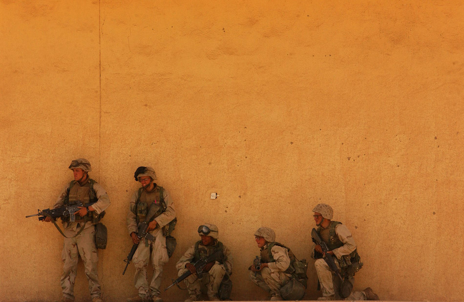 U.S. Marines secure buildings as they enter Saddam's stronghold of Tikrit.