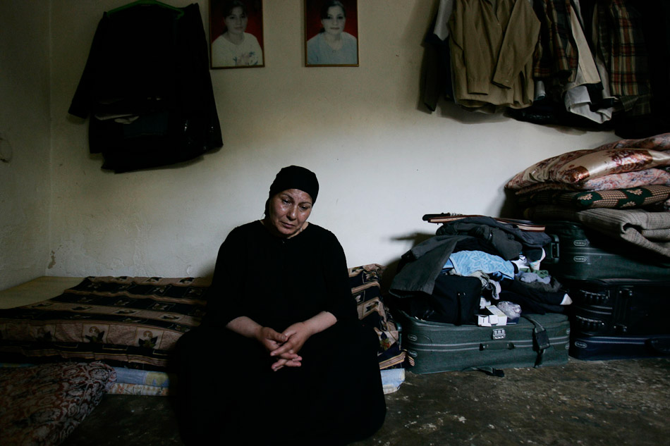Layla Salman and her husband fled Iraq with their remaining children after two of thier daughters were shot dead for working with the American military. Pictures of the two deceased daughters hang over the mattresses where they sleep while waiting for asylum.