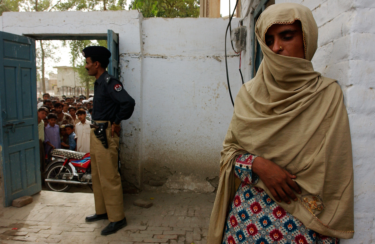 Locals gather around as Mukhtar Mai presses charges at the police station in Jatoi.