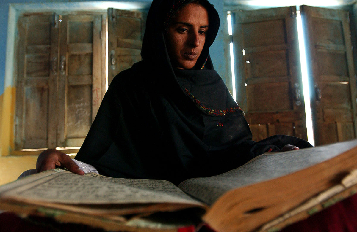 Mukhtar Mai reads the Koran.