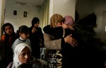 Family and communitymembers gather at the home of twenty-four year old Ahmed Mahmood Masherka's home to mourn and celebrate his life. Mahmood killed himself and three others on March 30, 2006 in a suicide attack. Militant group al-Aqsa claimed responsibility.