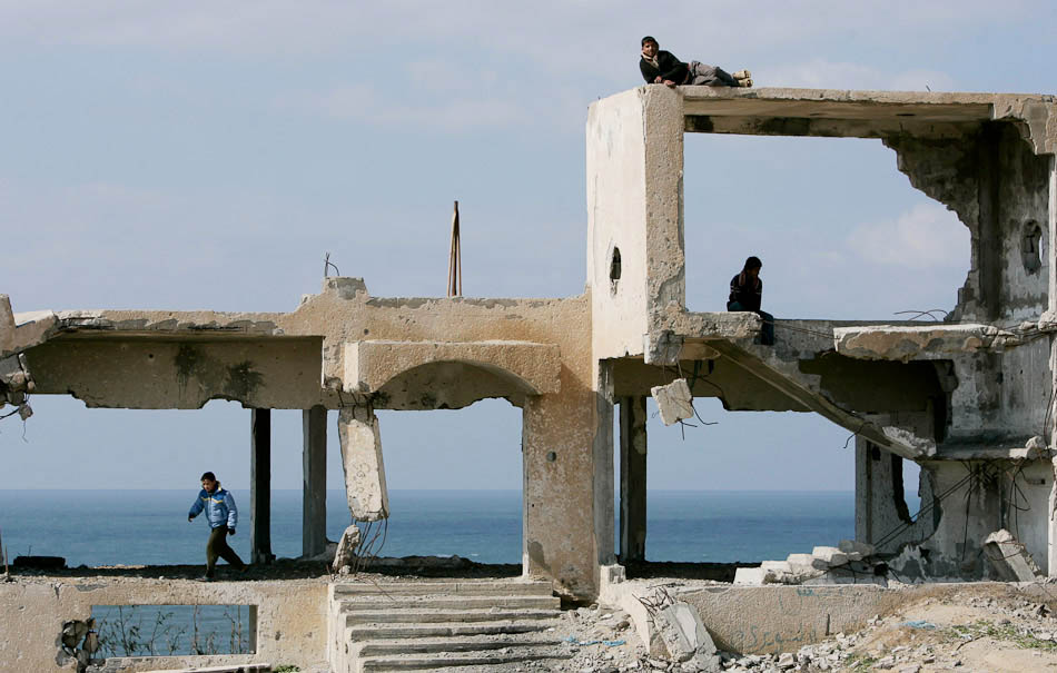 Children in the Gaza Strip play on the remains of a police station that was destroyed by an Israeli F-16.