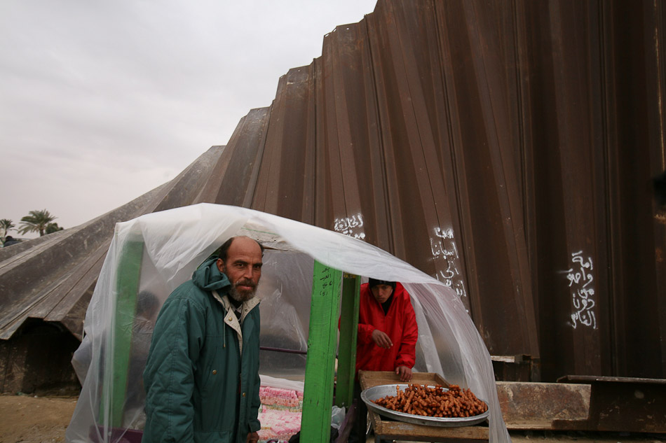 A Palestinain vendor sells snack food at the Rafah border crossing.