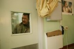 Khalid Akram al Kolak cries as he looks through the window of the ICU. His daughter, Aya al Quolak, was in need of urgent surgery at the Soroka Hospital in Israel. It took 4 days to get clearance from the IDF for her to travel. She was then transfered into Israeli custody after  crossing Erez. Her parents were not allowed to travlel with the toddler. 