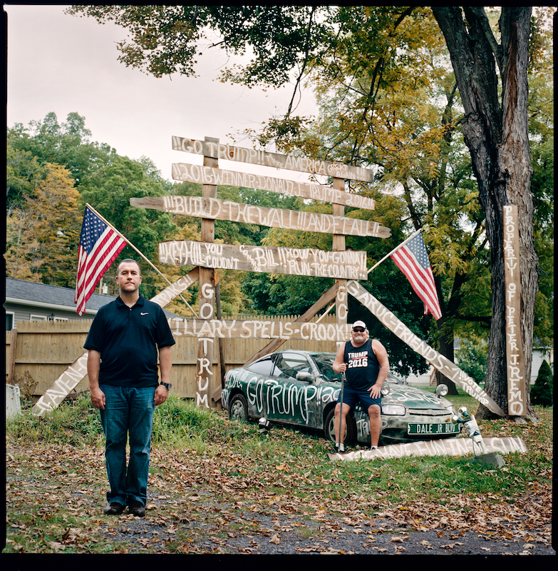 Jay Garuc (l) and Stevie Tirpak (r), Oak Hill, NY. October 4th 2016. Sign built in April 2016. Chevrolet Cavalier 2004, pine slab wood, paint, flags. Inspired by attending Trump's Albany, NY rally.
