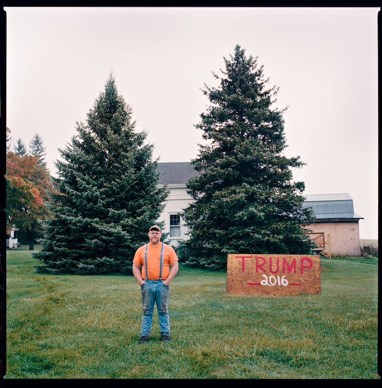 Adam-Wayne Therrien, Greenville, NY. October 1st 2016.Sign built in May 2016. Plywood and paint. Saw others putting up signs and was inspired to make his own. Truly loves America and believes Trump will bring industry and jobs back.