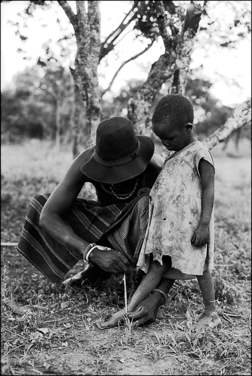 <i>Father Tying Child's Laces</i>Mugie Ranch, Kenya, August 2002