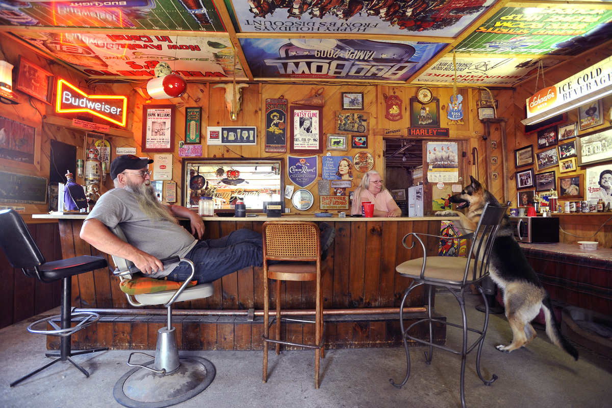 Retired Pfizer researcher Dave Karlson, left, watches as Jean Sweet's German Shepherd Fraulein {quote}bellies up{quote} to the bar on command. Jean Sweet and her husband Wayne (not pictured here) have owned Sanford Haney Farm, a poultry farm in Brooklyn, for 33 years.