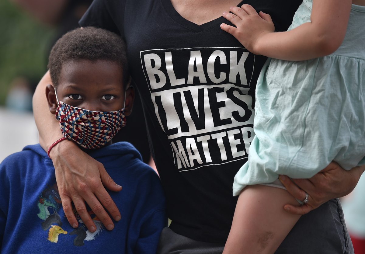 Daniel Sullivan, 4, left, of West Hartford, stands with his family at an {quote}I Can't Breathe{quote} rally at the State Capitol late Friday afternoon. Members of different organizations and communities were there to rally against police violence and killings of people of color.