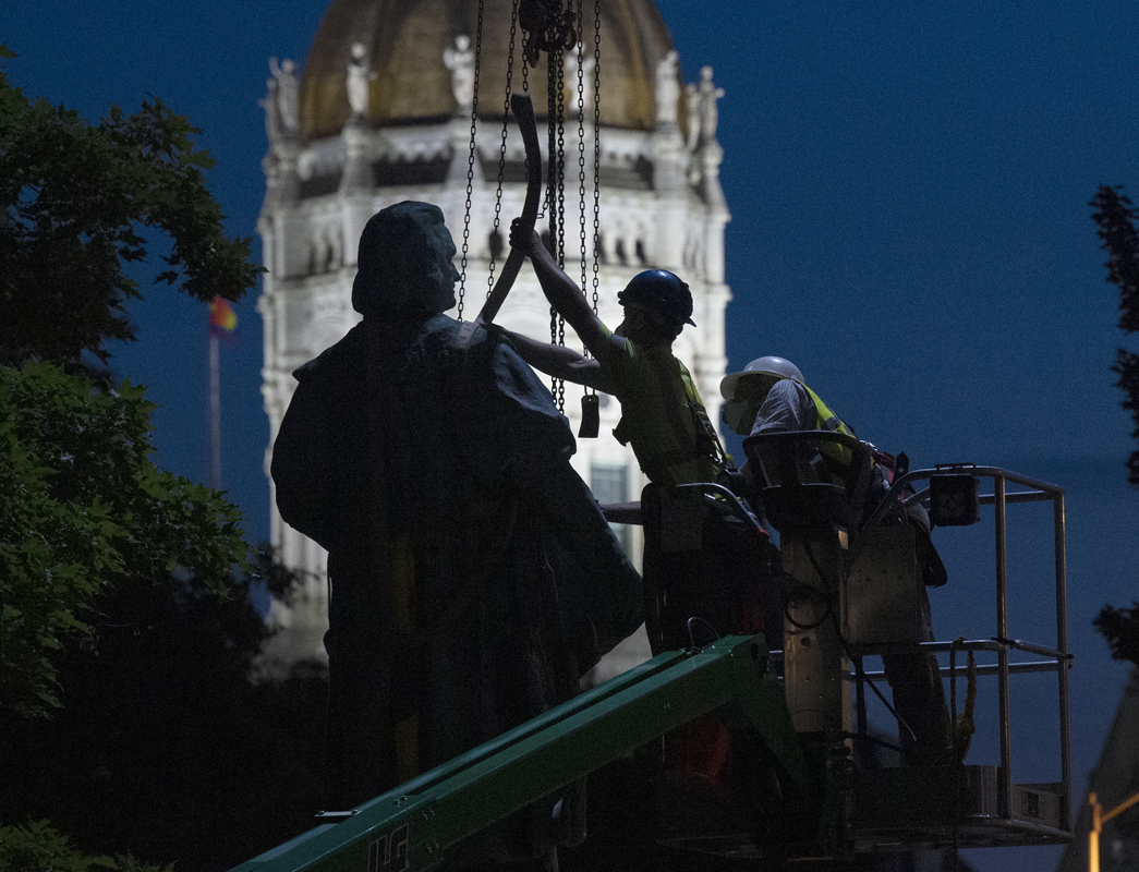 A crew removed a statue of Christopher Columbus from Columbus Green in Hartford early Monday morning.