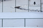 A man walks through sunny Stanley Quarter Park in New Britain Thursday afternoon.